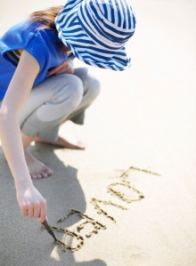 Woman Writing in the Sand