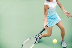 Woman Returning Tennis Volley